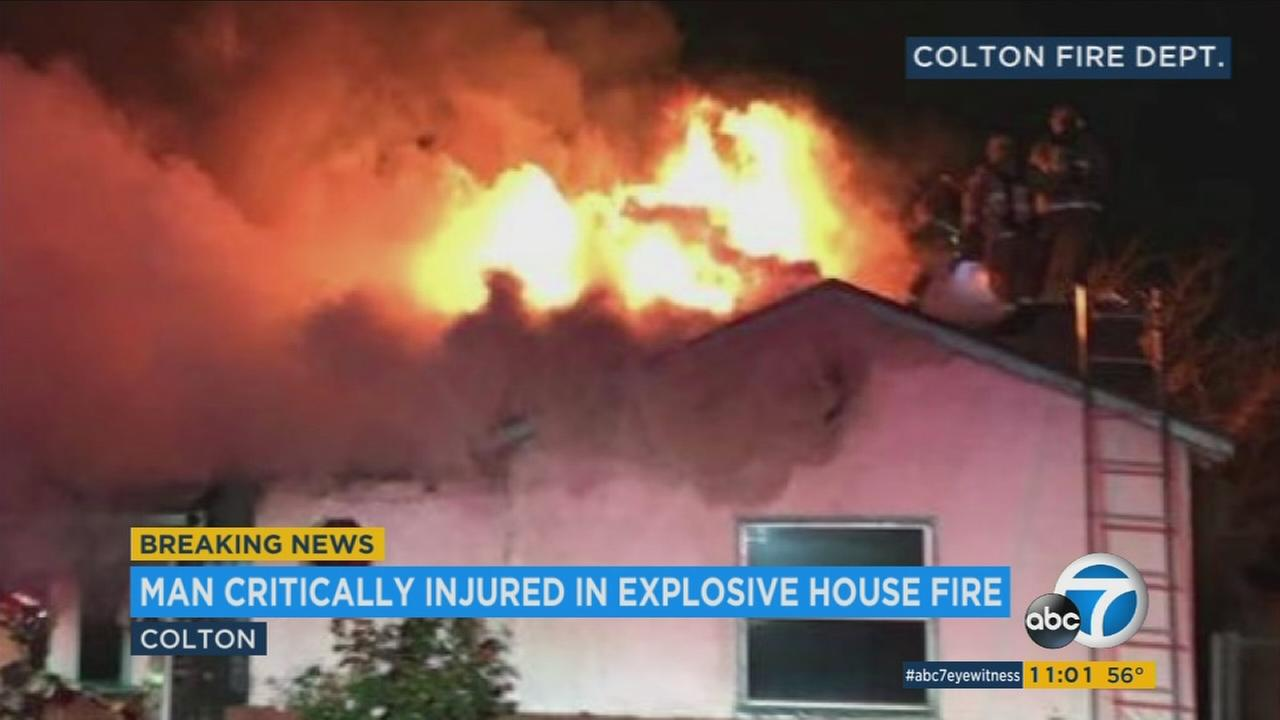 Firefighters stand on the roof of a home in Colton as flames rip through the structure on Thursday, Jan. 4, 2017.