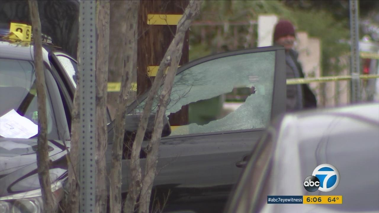 A shattered drivers side window is shown as authorities investigated the fatal shooting of a woman in Sylmar on Saturday, Jan. 7, 2017.