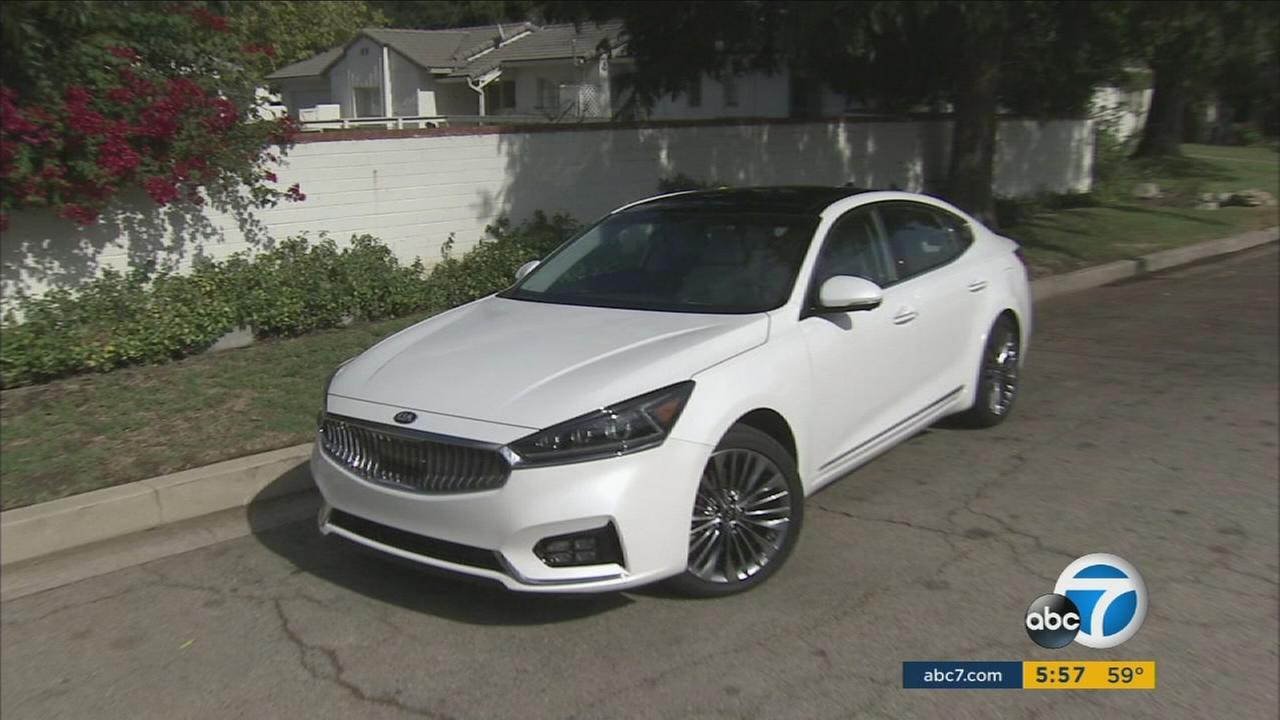Automakers like Kia are adding new features to keep conventional sedans appealing.