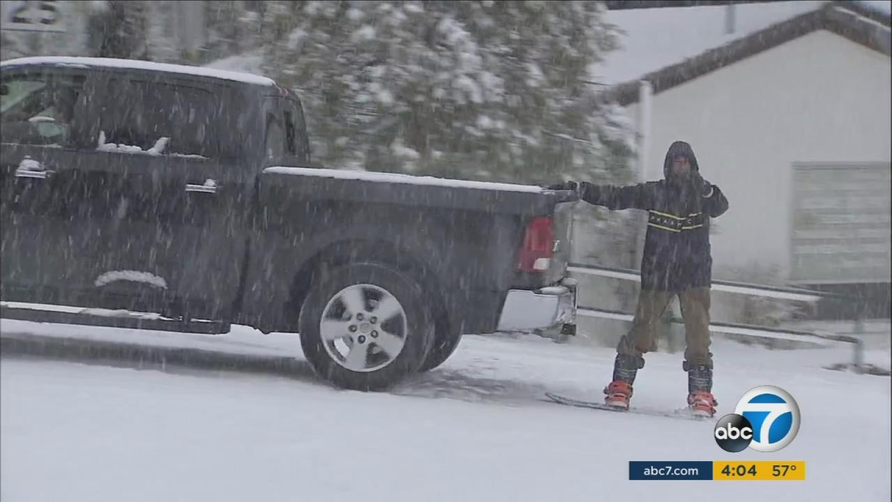 With high winds keeping ski resorts empty, some people in the Inland Empire found their own ways to enjoy the heavy snow.