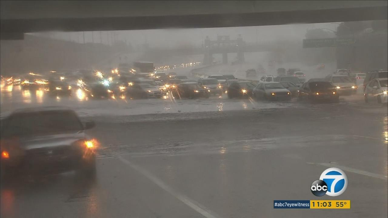 Vehicles are seen flooded in rainfall as they drive through a freeway in Southern California on Sunday, Jan. 22, 2017.