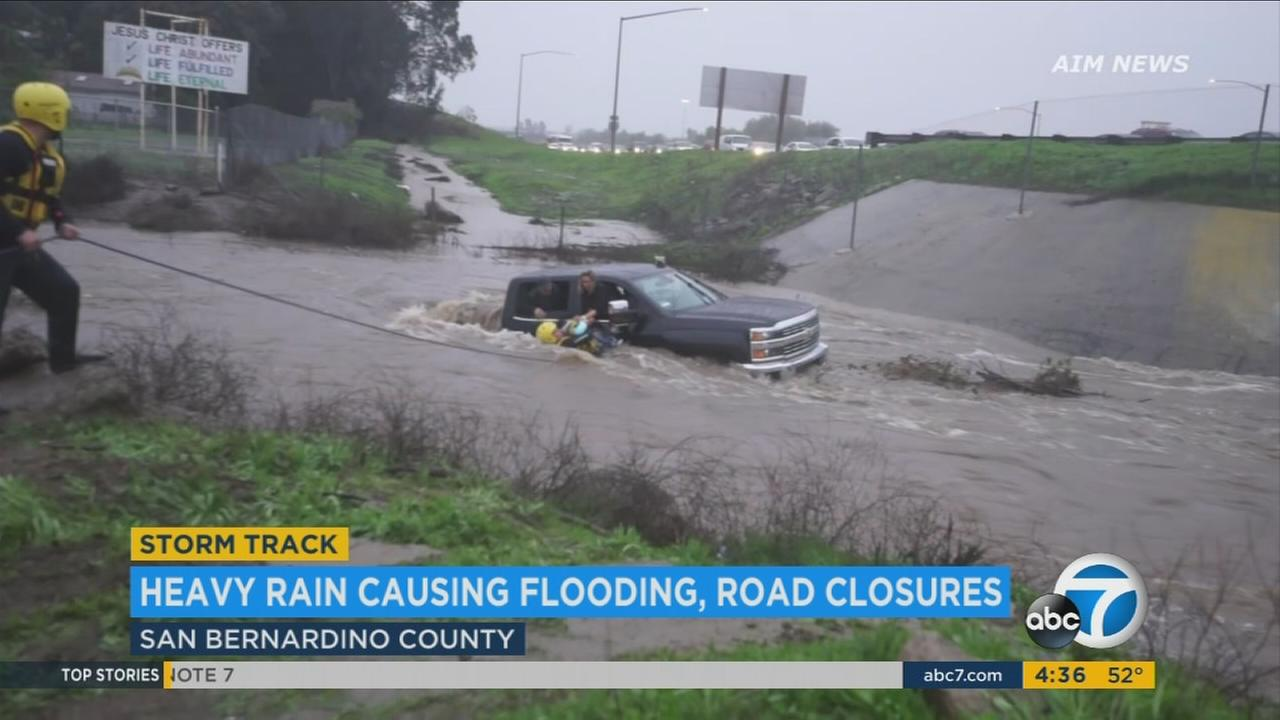 Firefighters rescued a family after their pickup truck became stranded on a flooded road in Murrieta on Sunday, Jan. 22, 2017.