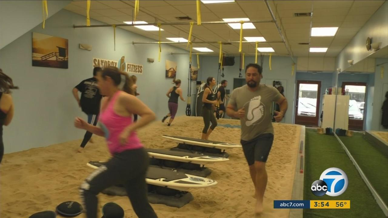 People attend Sandbox Fitness, a place in Sherman Oaks that uses sand to ease the harshness of workouts and still get the full benefits.