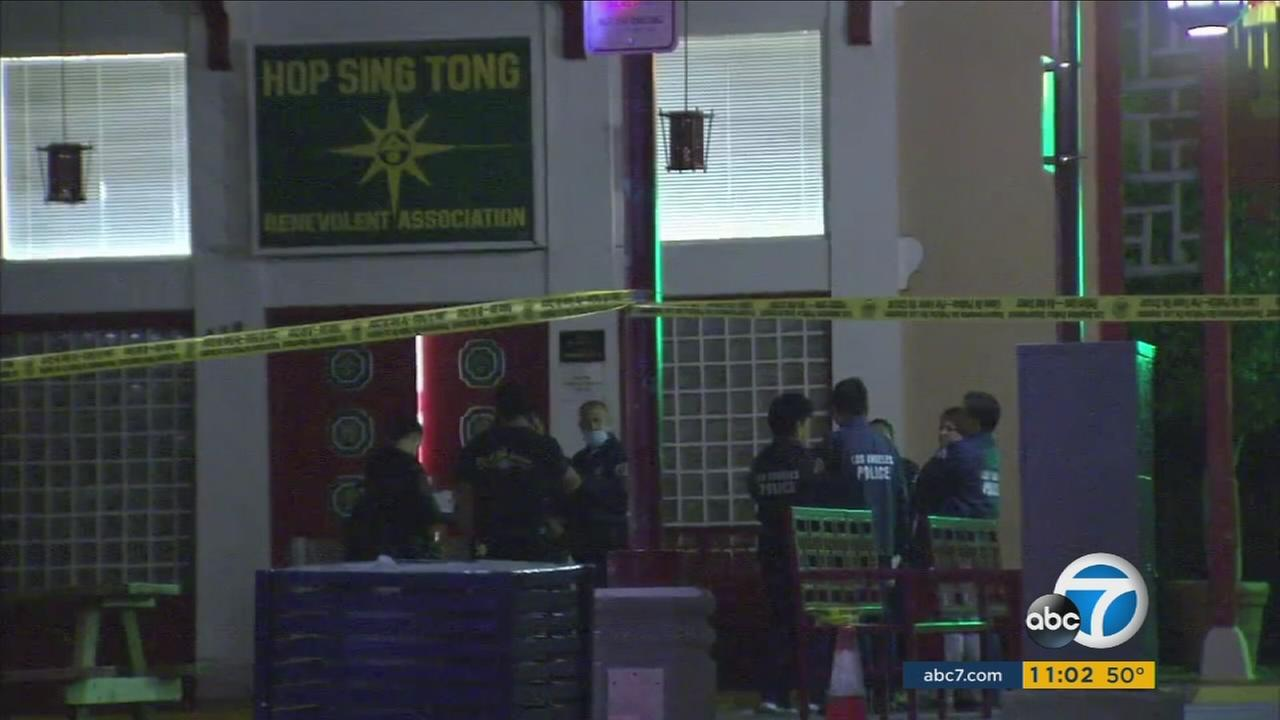 Authorities surrounded the scene of a double murder near the Hop Sing Tong Benevolent Association in Chinatown on Thursday, Jan. 26, 2017.