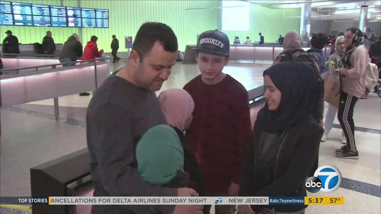 A refugee father reunites with his children at Los Angeles International Airport on Sunday, Jan. 30, 2017.