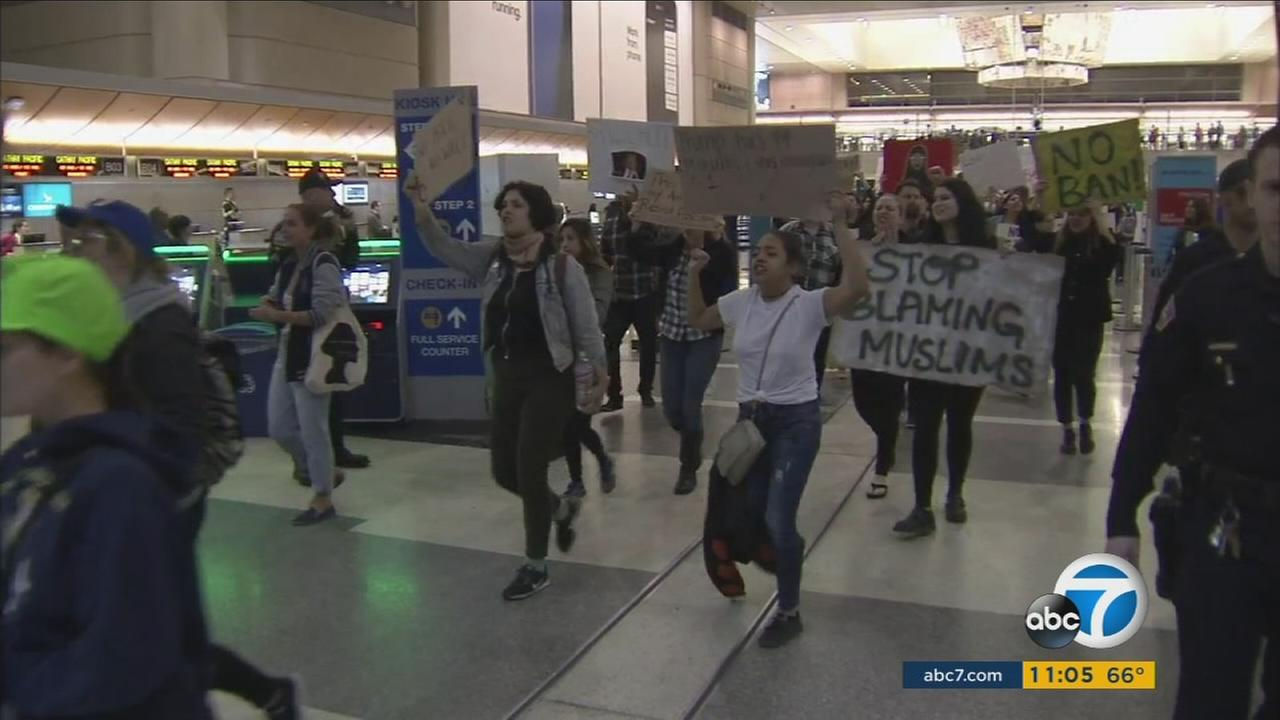 Protests are continuing at LAX and other airports around the country where refugees and people from seven Muslim-majority countries are being detained under an executive order from President Donald Trump.