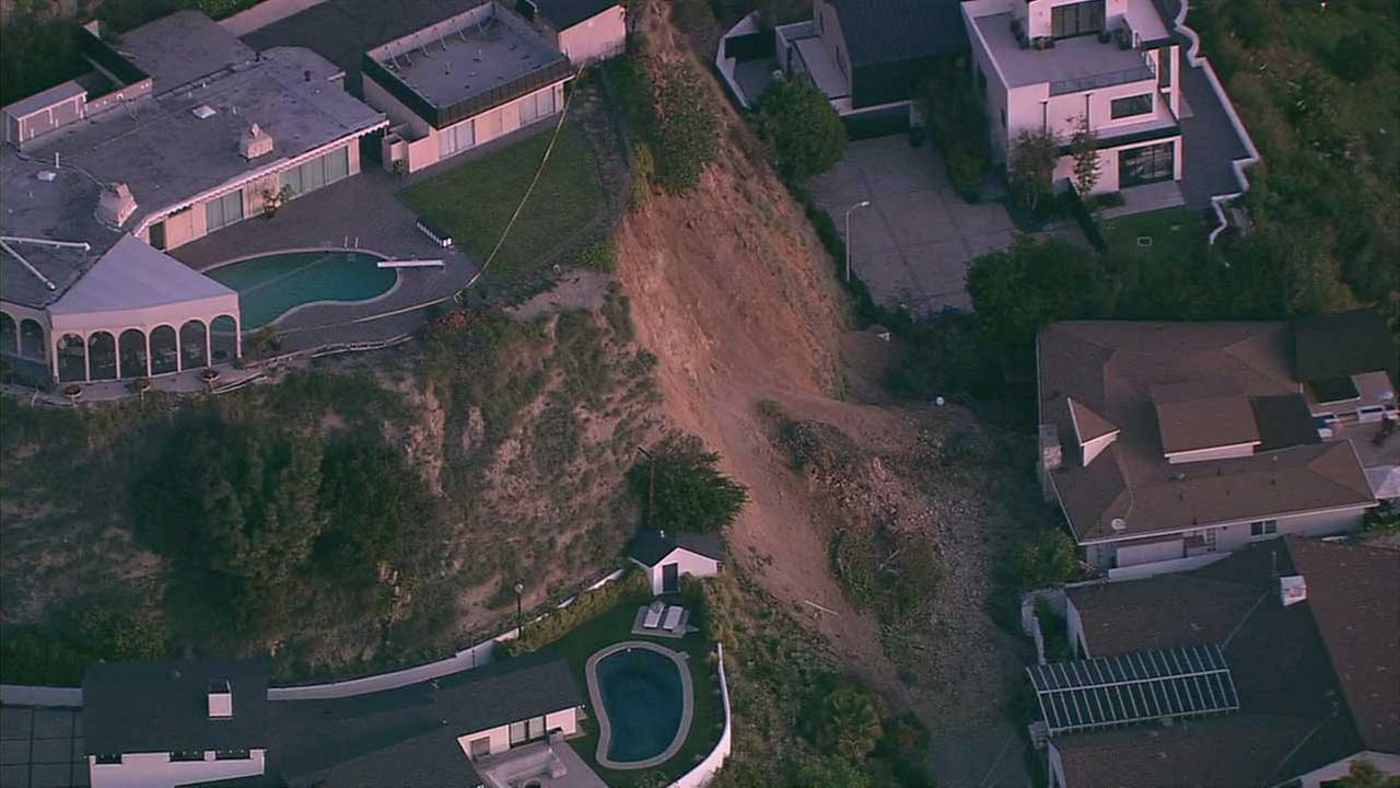 A hillside gave way in the Hollywood Hills, sending mud and debris tumbling down into the yards of at least two homes on Monday, Jan. 30, 2017.