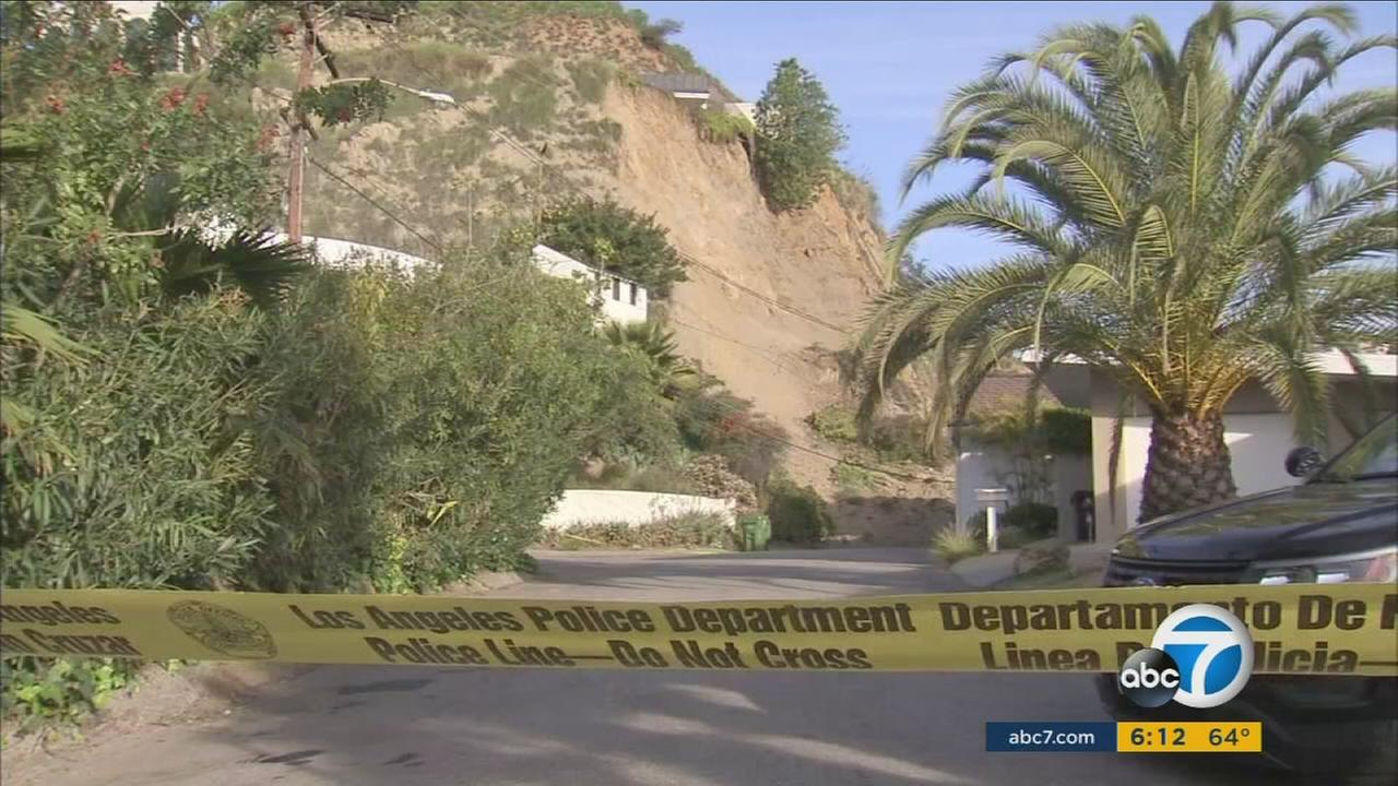 After a landslide forced the evacuation of five homes in the Hollywood Hills, crews are still assessing the safety of the hillside before they can remove the debris.