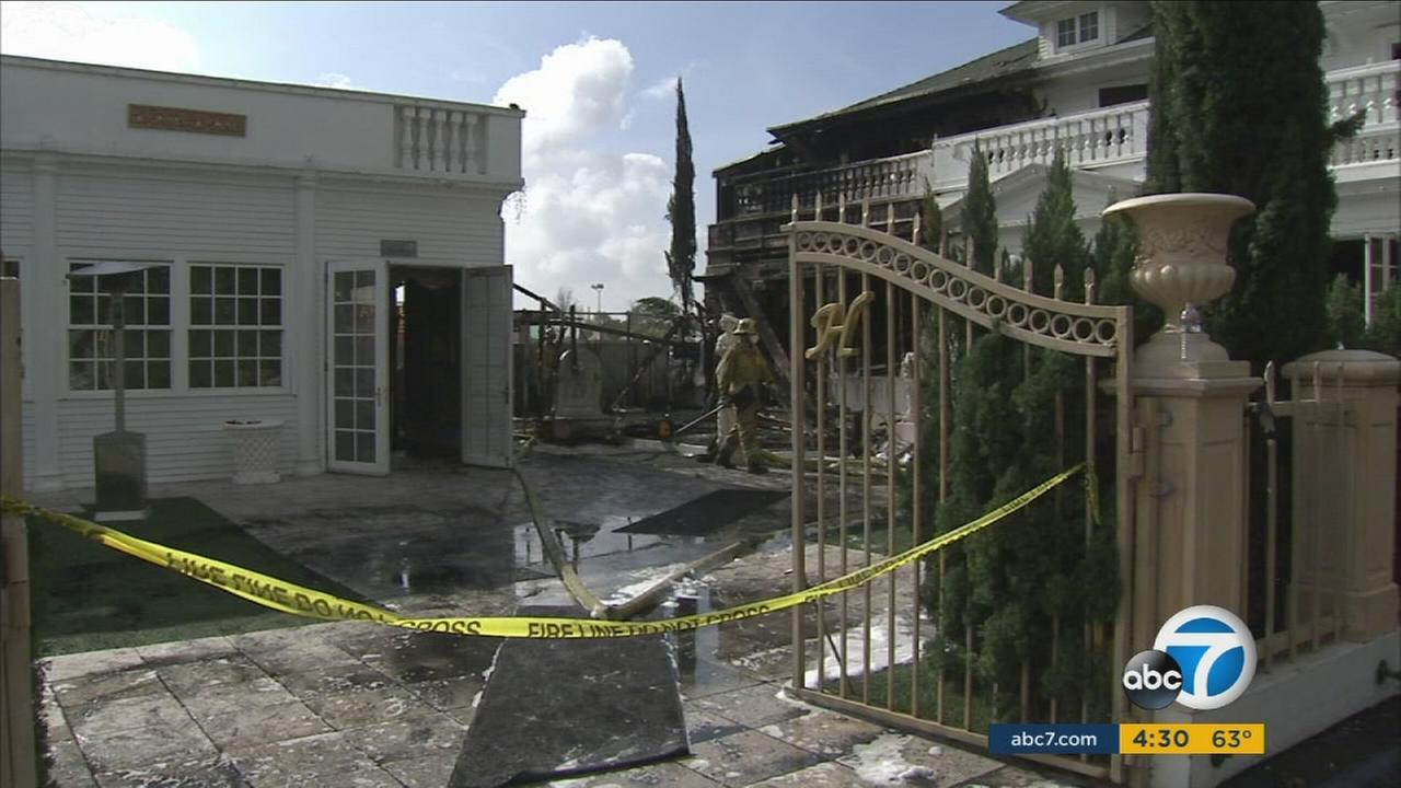Firefighters looked over the heavy damage caused by a possible electrical fire at the Anaheim White House restaurant on Saturday, Feb. 4, 2017.