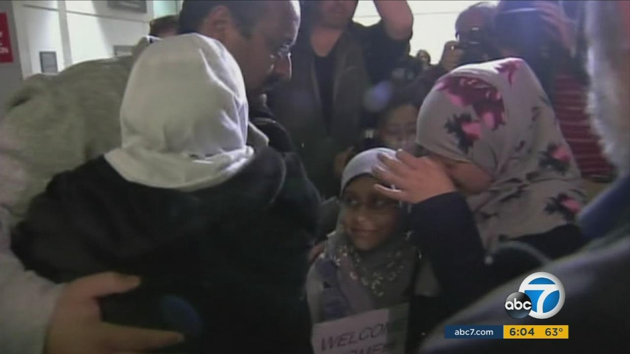 Travelers and immigrants gave emotional testimony to the Los Angeles City Council about the impact President Trumps travel ban has had on their lives.