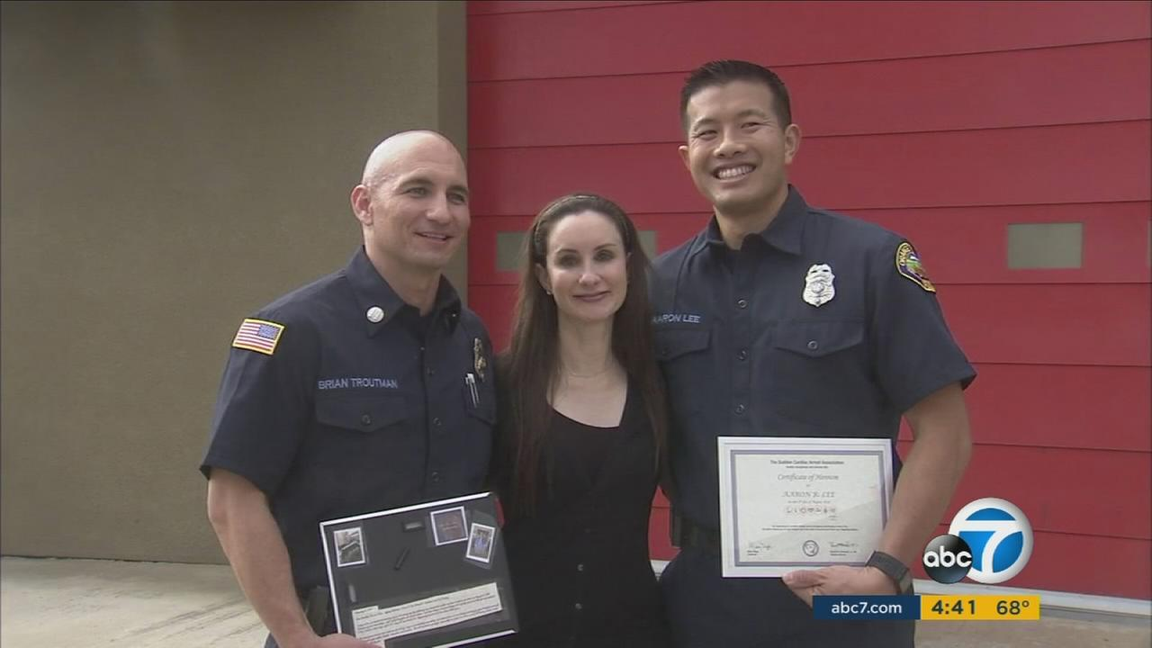 Stephanie Gavshon thanked and honored the Orange County Fire Authority paramedics with certificates and hero pins from the Sudden Cardiac Arrest Association.