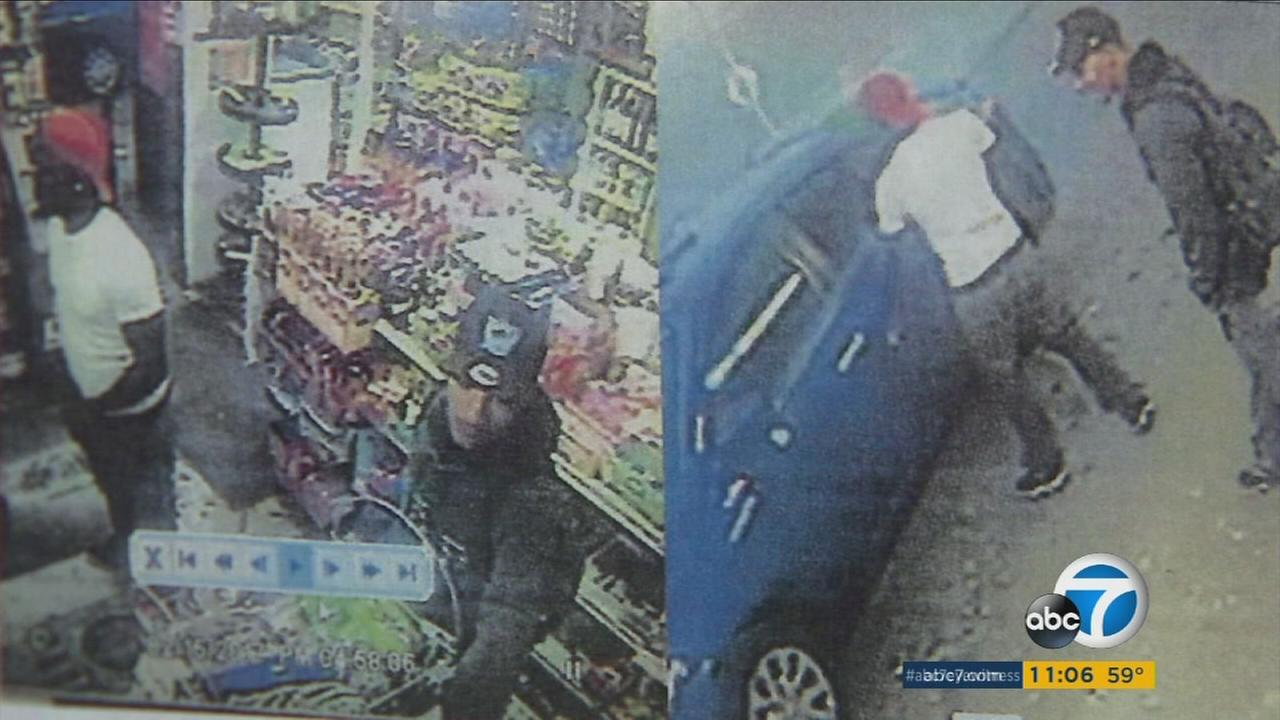 Surveillance video captured suspects wanted in the theft of a car with a 3-month-old baby inside on Wednesday, Feb. 15, 2017, in South Los Angeles.