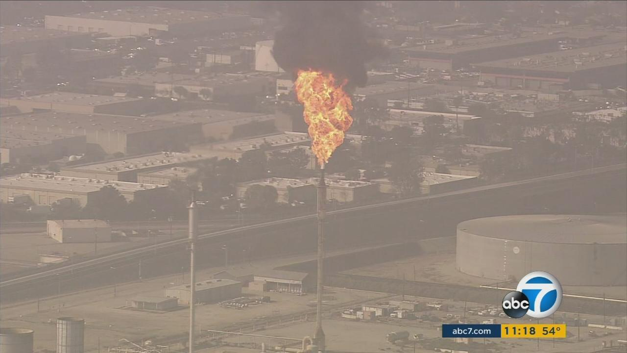 Fire is seen shooting out of the Torrance ExxonMobil Refinery in an undated photo.