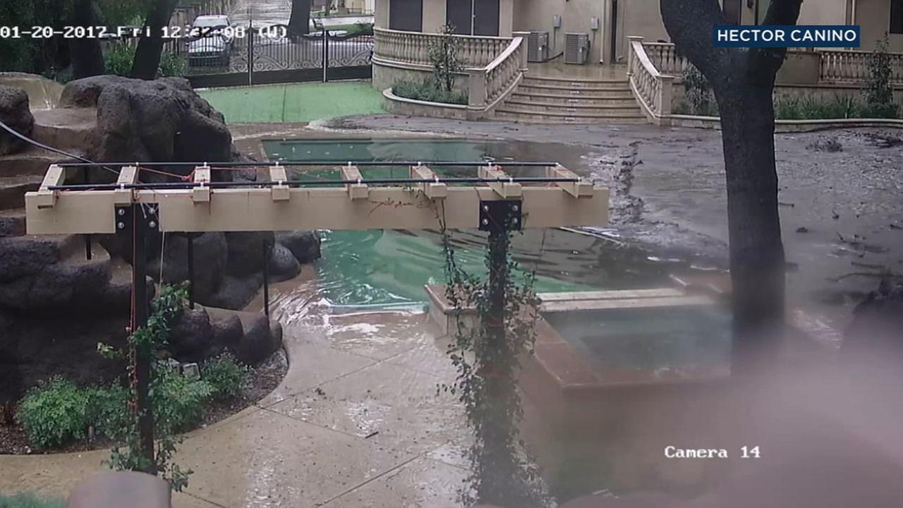 Mud flowed into the backyard of a Santa Clarita resident after a massive storm hit the area.