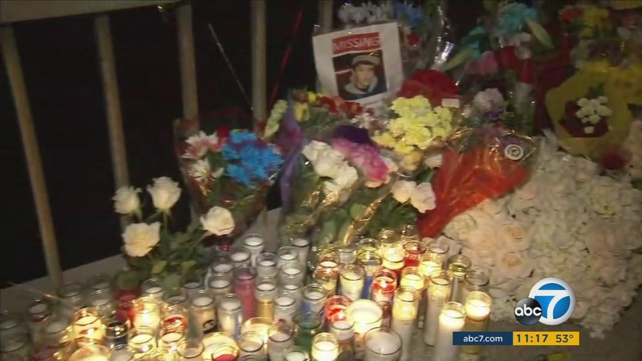Flowers and candles set up near the photo of 14-year-old Elias Rodriguez, who went missing for over a week after being found dead in the LA River on Saturday, Feb. 26, 2017.