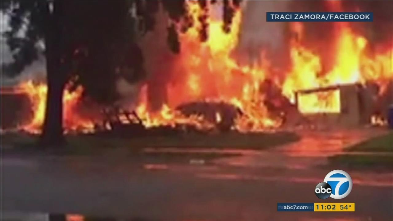 A witness captures the fireball that covers a home after a plane crashed into it in Riverside on Monday, Feb. 27, 2017.