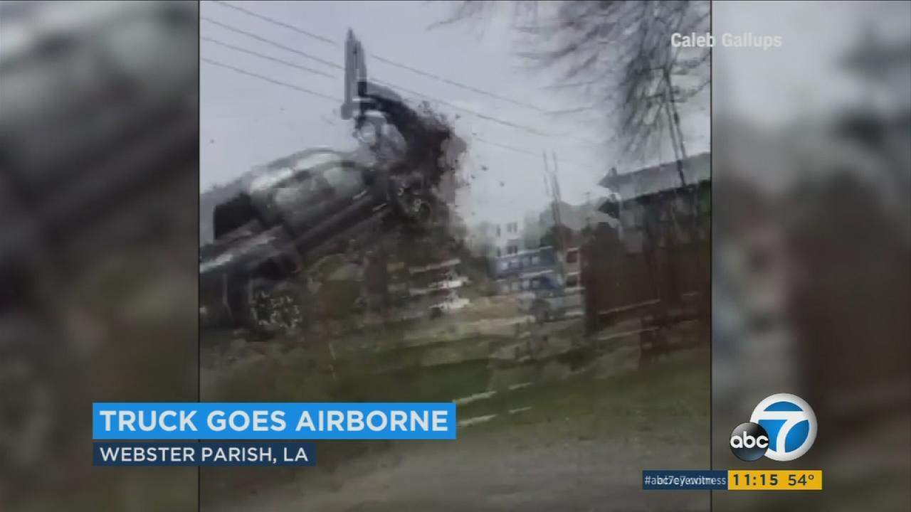 A Louisiana police chase came to a dramatic end when a truck soared through the air and landed on a parked car Wednesday afternoon.