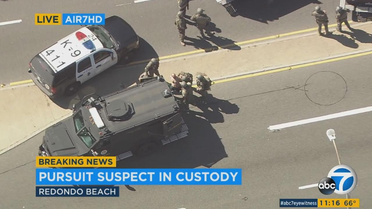 A chase suspect surrenders to police after a chase that ended in Redondo Beach on Wednesday, March 1, 2017.
