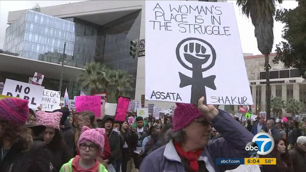 Protesters hold signs during the third annual International Womens Day March and Rally in downtown Los Angeles on Sunday, March 5, 2017.