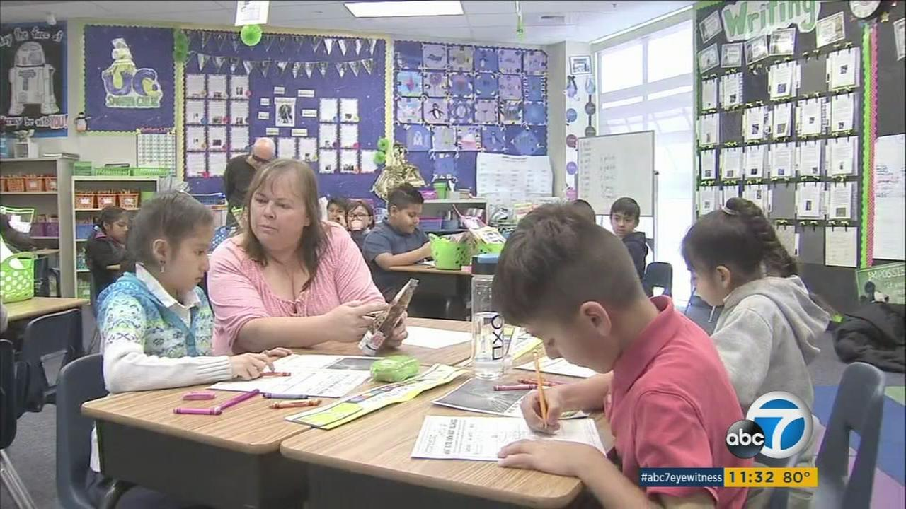 A classroom with students and a teacher that is part of the Santa Ana Unified School District is shown in a photo.