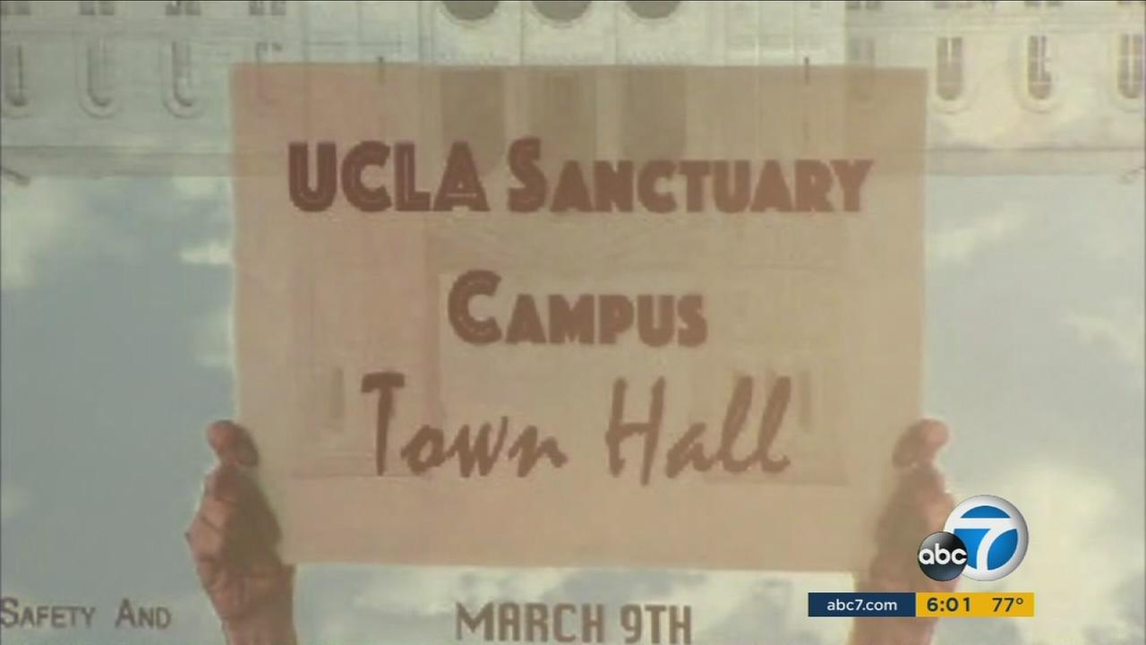 A sign showing the demand for UCLA to be turned into a sanctuary campus is shown.