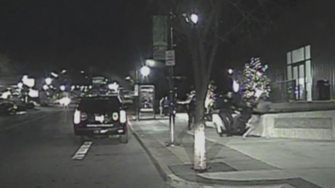 Video shows police in Arkansas tackling University of Oklahoma quarterback Baker Mayfield.