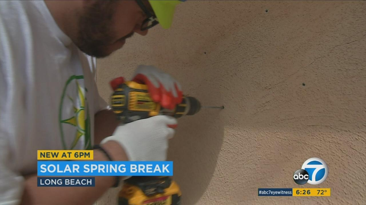 College students spent spring break volunteering in Long Beach to install free solar panels for low and moderate income families.