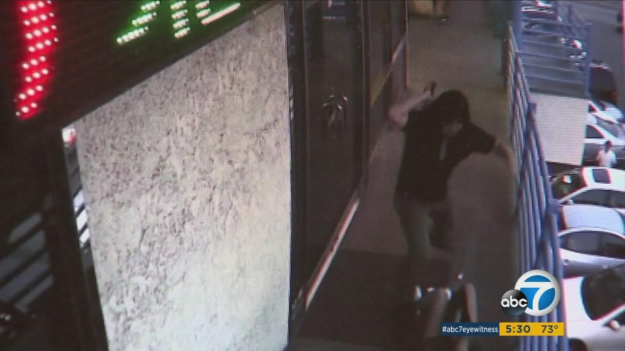 Surveillance footage shows a man attacking a Korean woman with a hammer in Koreatown.