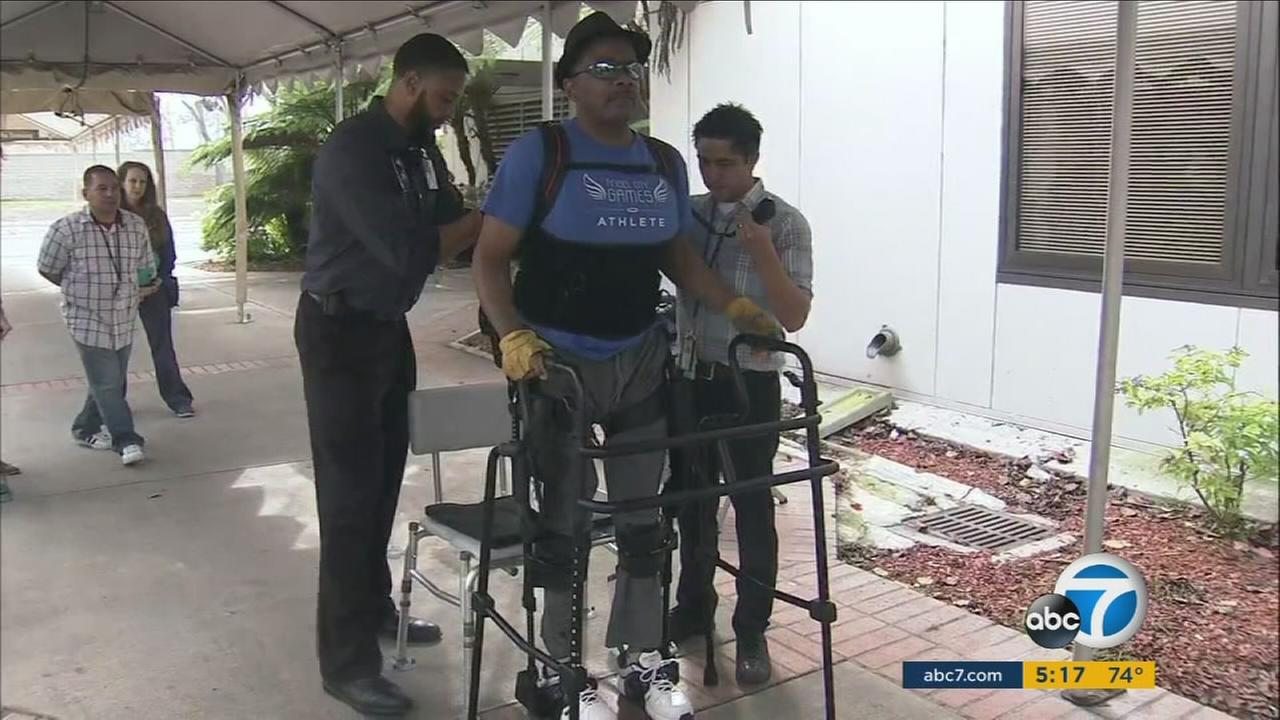 A new axis skeleton device donated to the Spinal Cord Injury Center in Long Beach is helping paralyzed veteran Cedric Delong stand and walk.