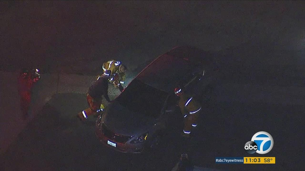 A woman driving home in Monterey Park was trapped in her car for hours when she ran over a power line that had been knocked down by an alleged drunk driving crash three blocks away.