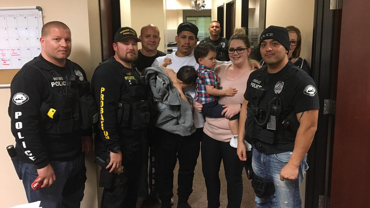 Cathedral City police officers are seen with two boys who were found safe in a car Friday, March 24, 2017, hours after it was stolen.