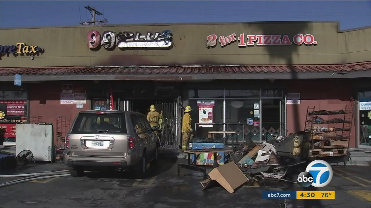 A man and woman believed to be owners of the 99-Cent-Plus store in South Los Angeles were killed in a fire at the strip mall early Tuesday.