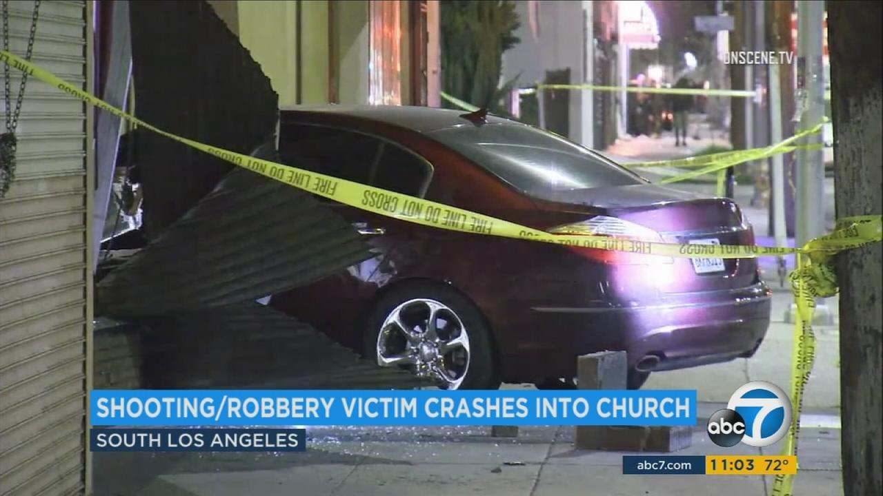 A vehicle seen halfway into a church building in Leimert Park after the driver was shot by three suspects on Wednesday, March 29, 2017.
