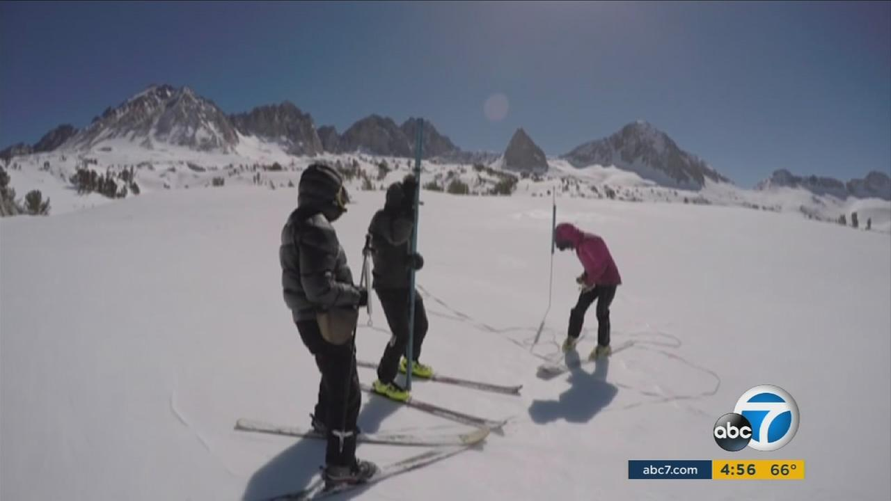 Surveyors ski high up to the Sierra Nevadas to measure Californias snowpack, just as they have for more than a century.