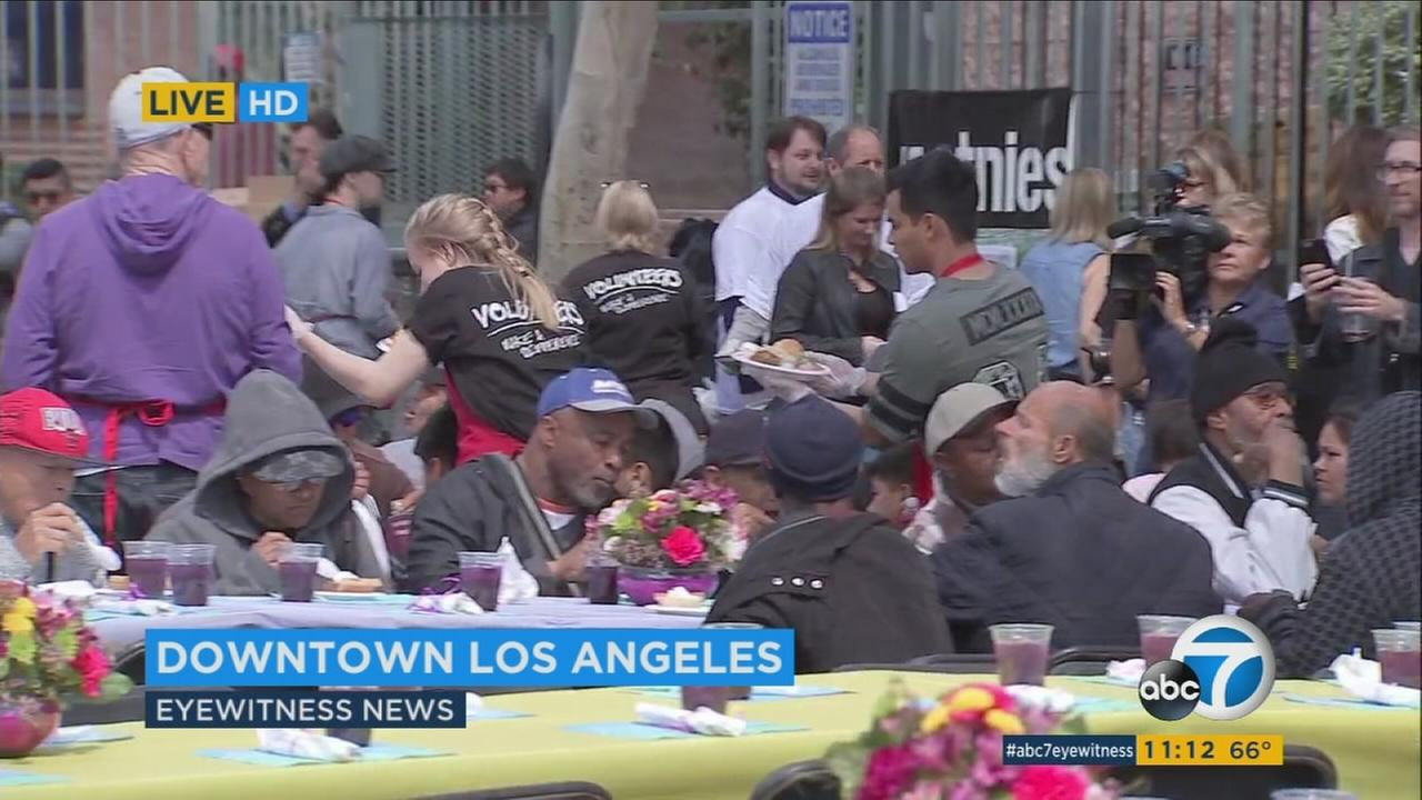 Dozens of volunteers, including several celebrities, served a Good Friday meal to thousands of homeless people at the Los Angeles Mission on Skid Row.