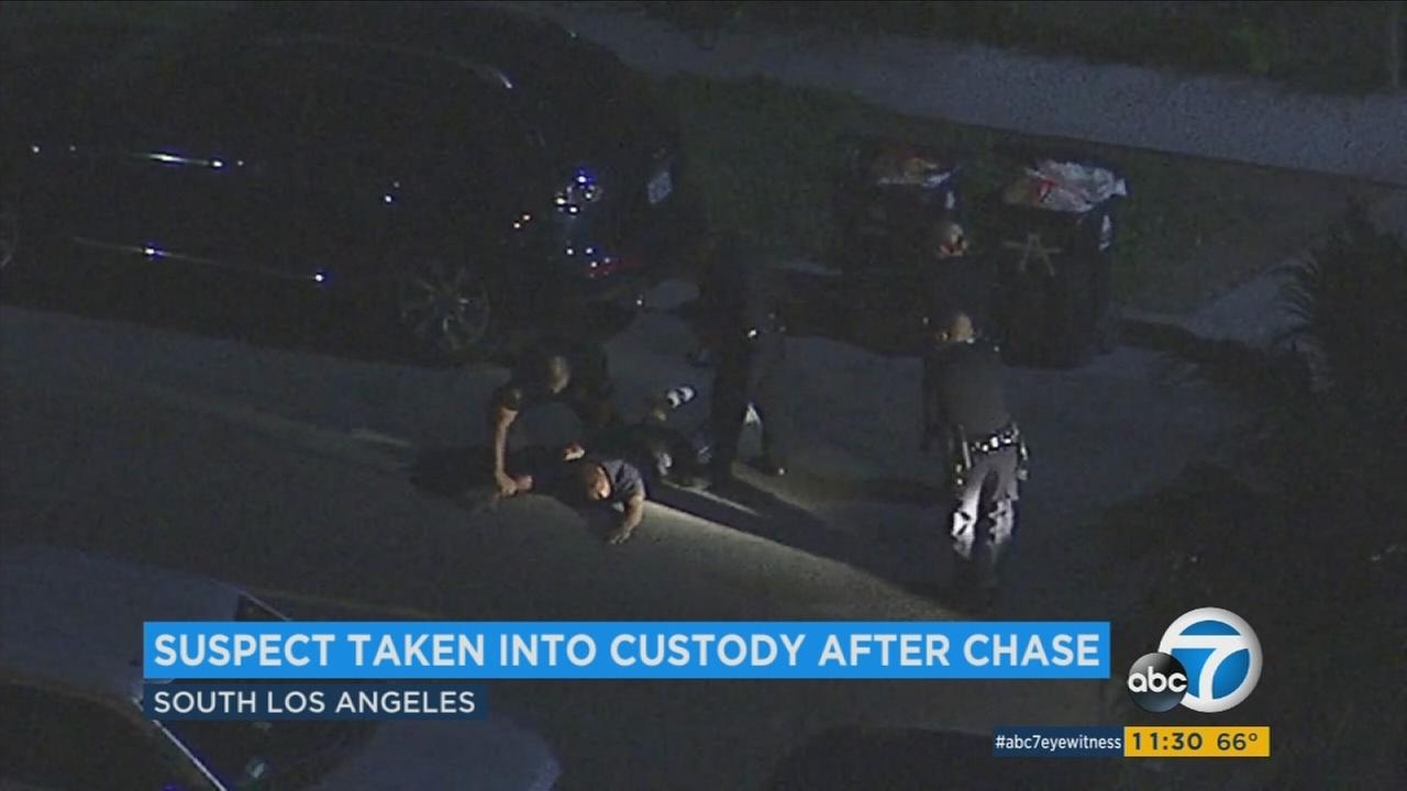 A chase suspect is arrested by police in South LA on Friday, April 14, 2017.