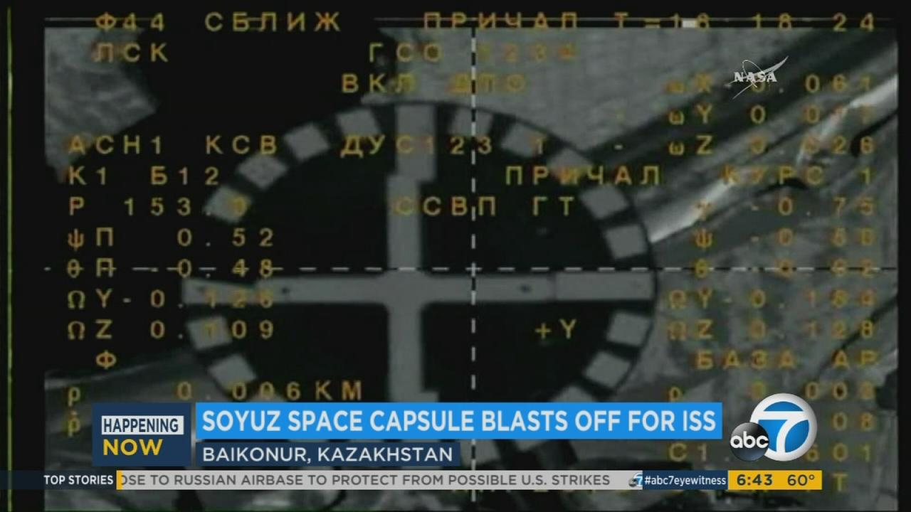 A Soyuz space capsule on Thursday safely delivered an American astronaut making his first space flight and a veteran Russian cosmonaut to the International Space Station.