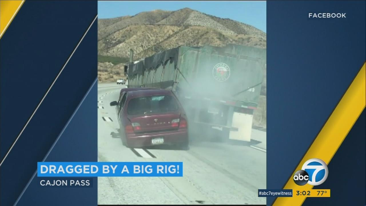 A car was dragged nearly a mile by a semitruck while in the Cajon Pass.