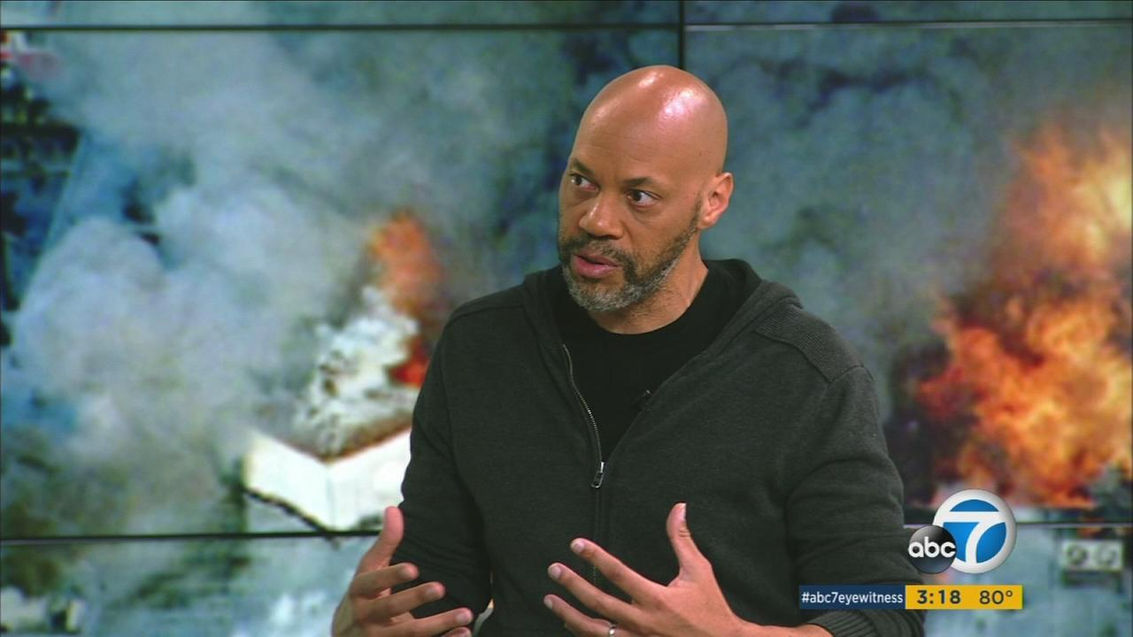 Director John Ridley is shown at the ABC7 studios discussing his documentary Let It Fall that focuses on the 1992 L.A. riots.