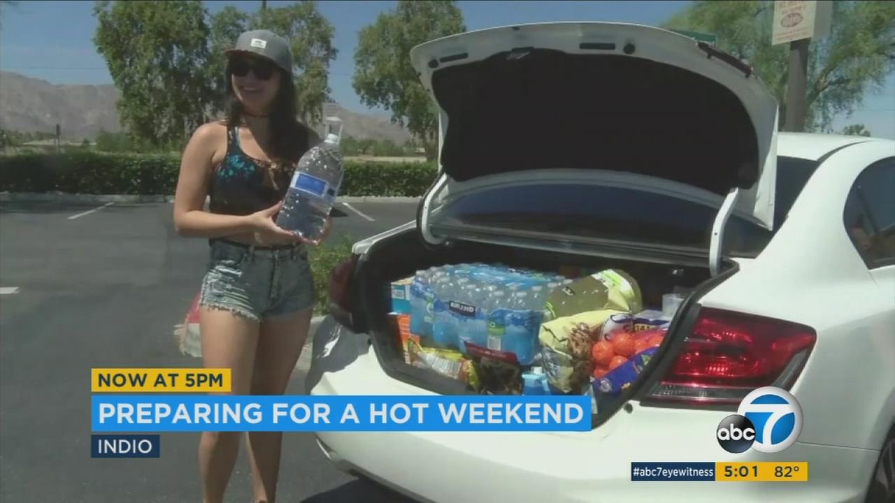 A Coachella attendee is prepared for summer-like temperatures on Friday, April 21, 2017.