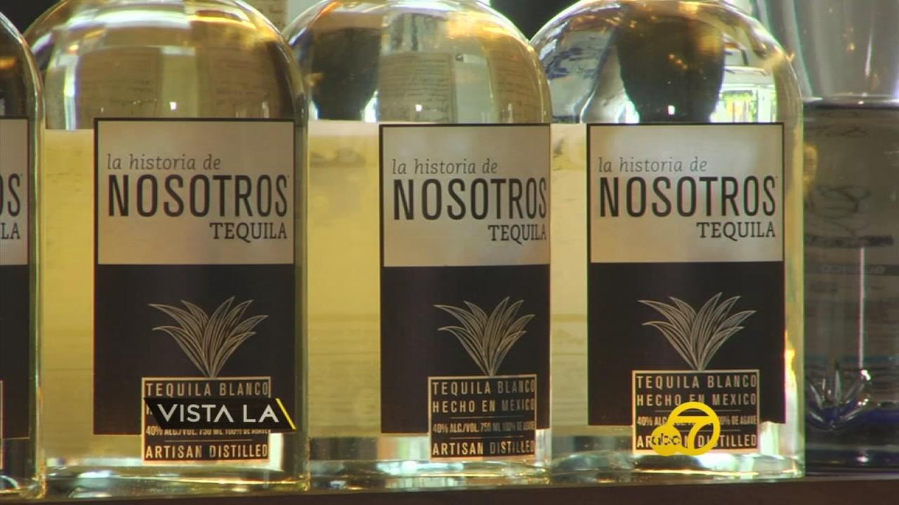 A display of La Historia de Nosotros Tequila bottles.