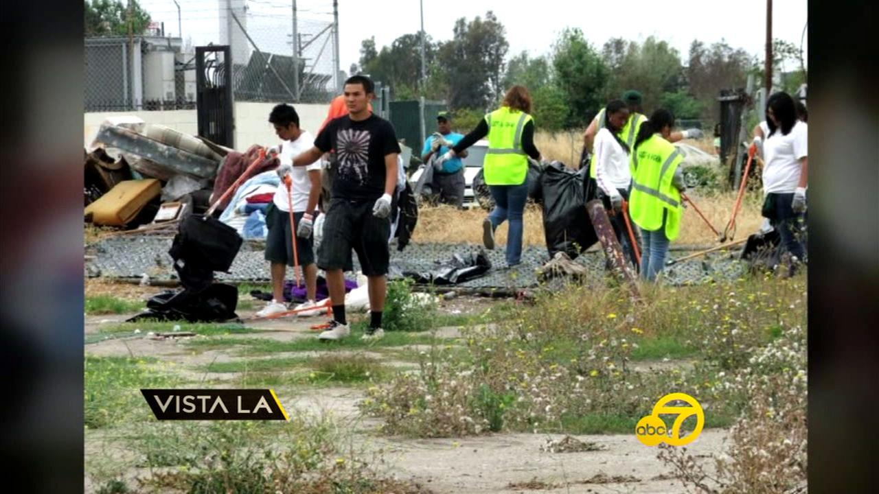 Members of From Lot to Spot work together to cleanup an empty lot in Los Angeles and create a space for families in the city.