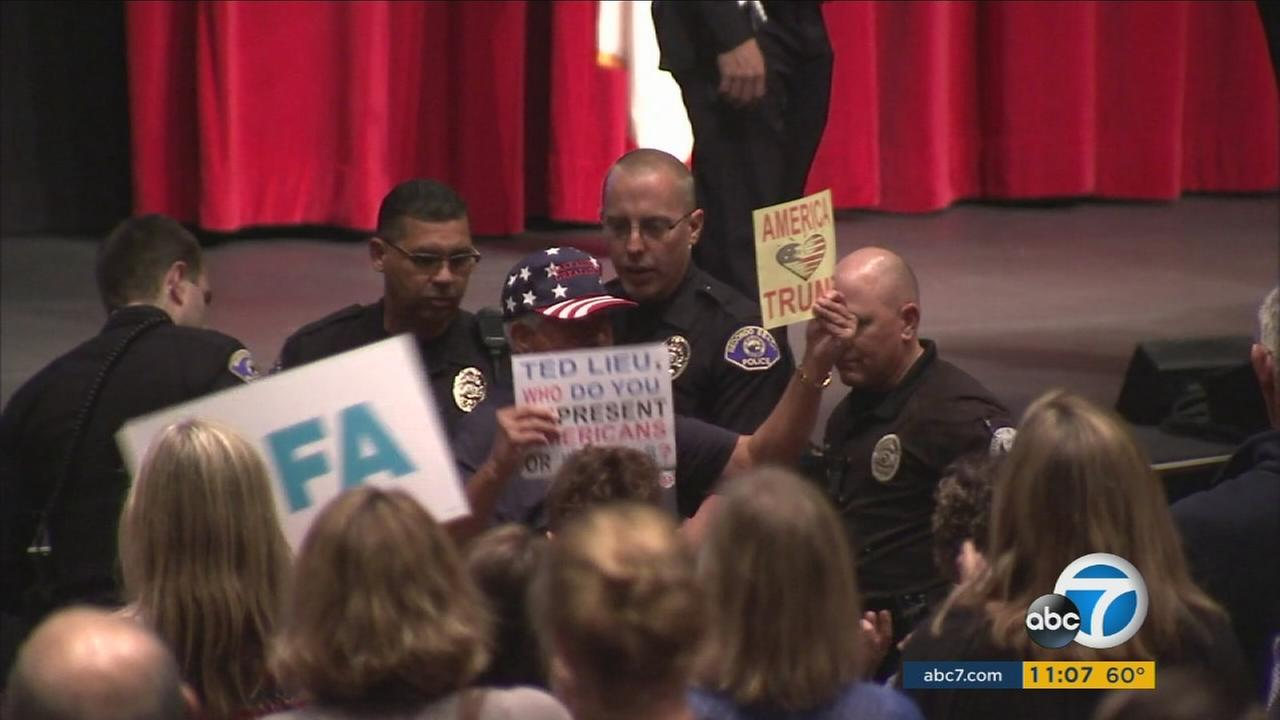 A Trump supporter was thrown out of a Redondo Beach town hall after repeatedly shouting liar as Rep. Ted Lieu spoke.