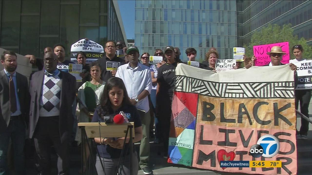 Protesters of measure C, also known as Amendment C, urge people to vote no while outside LAPD headquarters in L.A. on Tuesday, May 5, 2017.