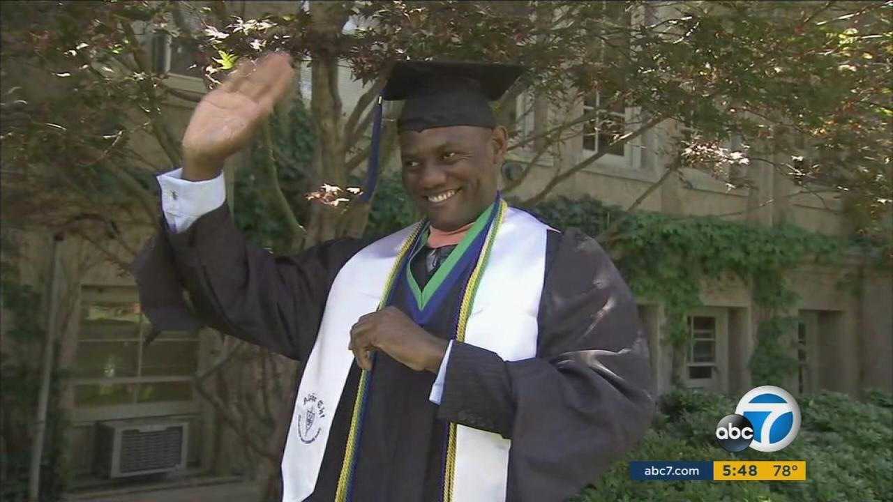 Ooceeh Afame is shown in his graduation uniform at the University of La Verne as he talks about his escape from slavery in Nigeria.