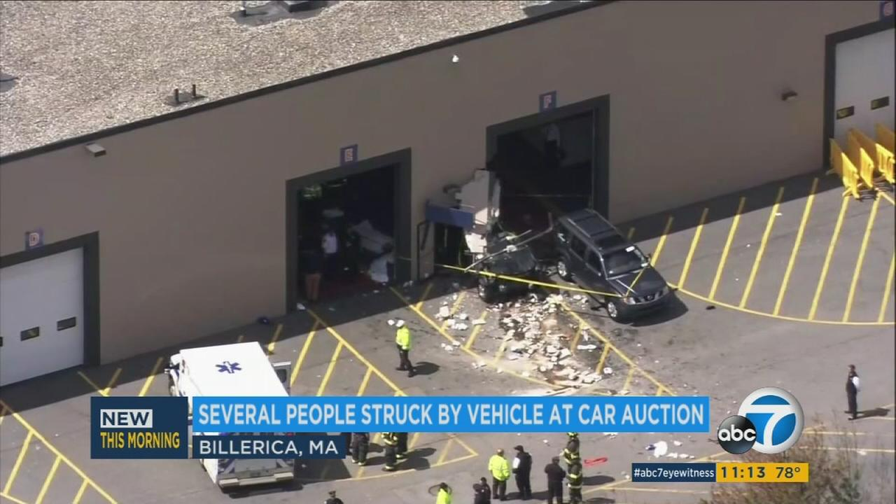 A vehicle is seen protruding from a building in Massachusetts on Wednesday, May 3, 2017.