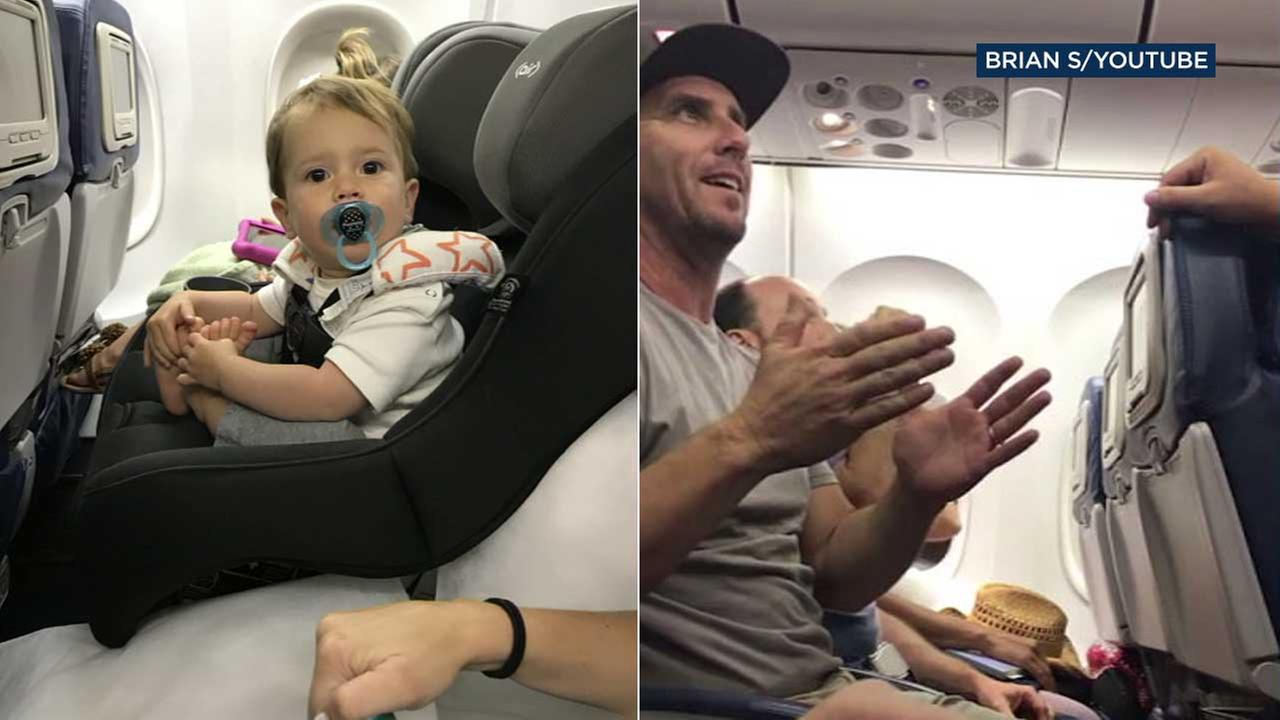 Brian Schear, right, is seen on a Delta flight, which he and his family members, including young son Grayson, left, were kicked off from following a dispute with the airline.