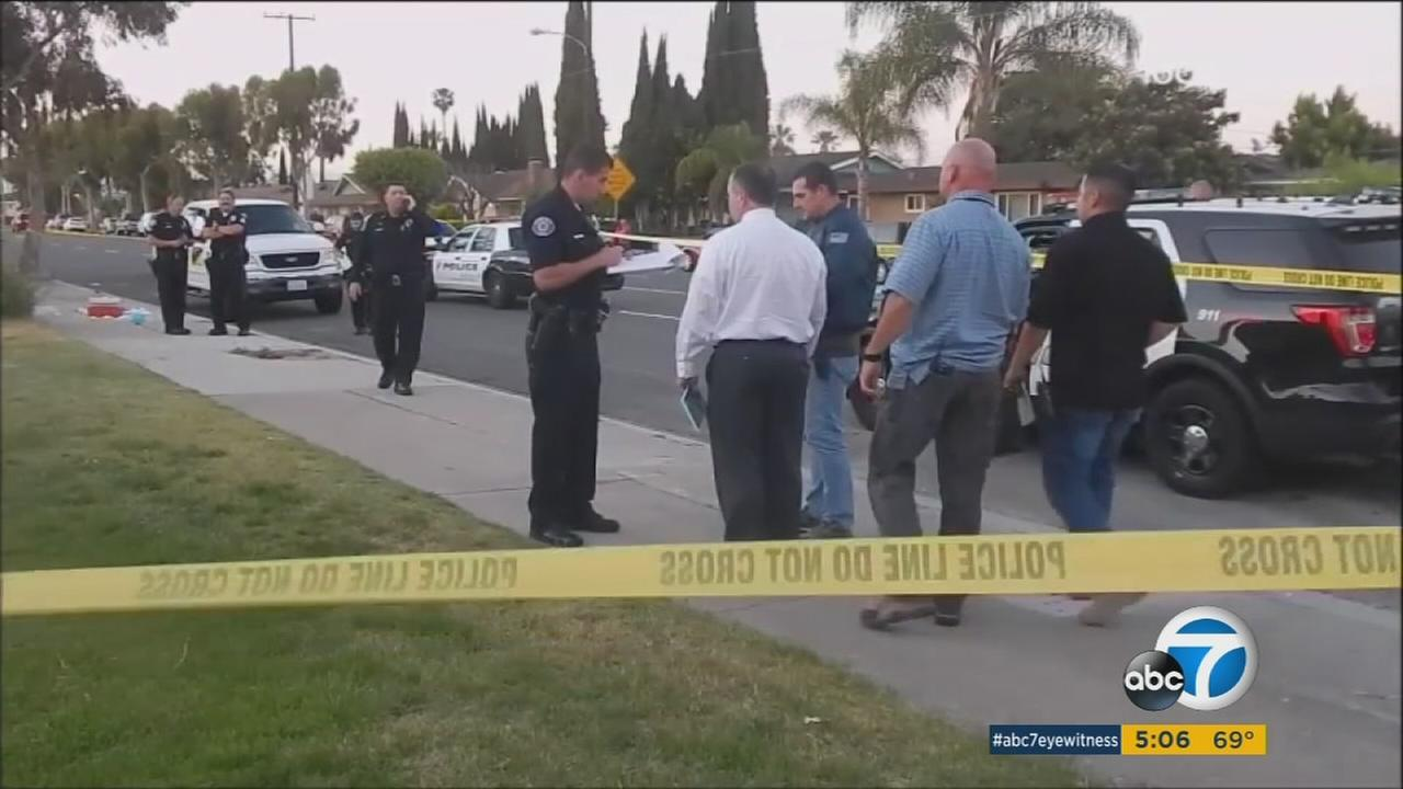 Authorities interview witnesses and surround a Garden Grove neighborhood after a mother was stabbed to death.