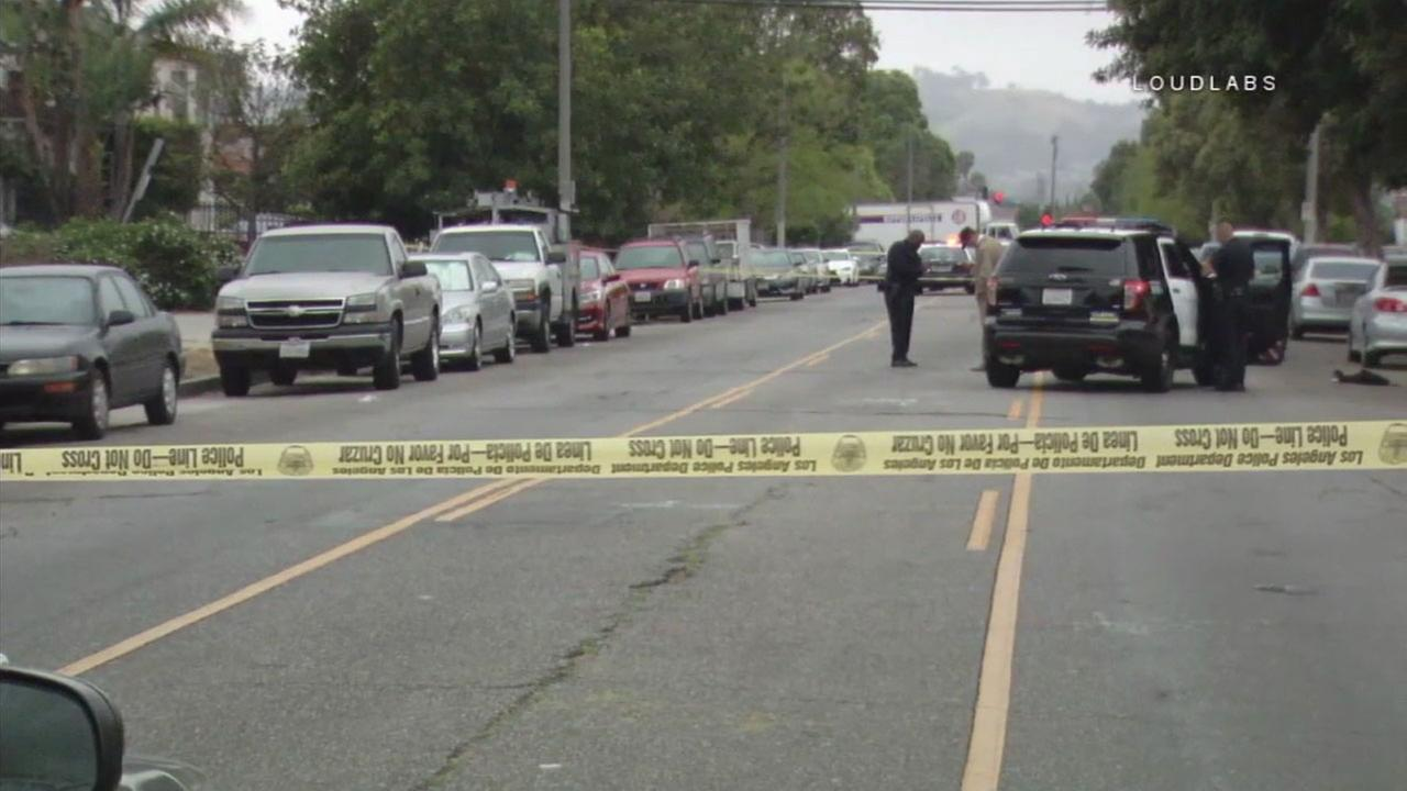 Authorities cordoned off a street in a Mid-City neighborhood after a man was shot to death on Saturday, May 6, 2017.