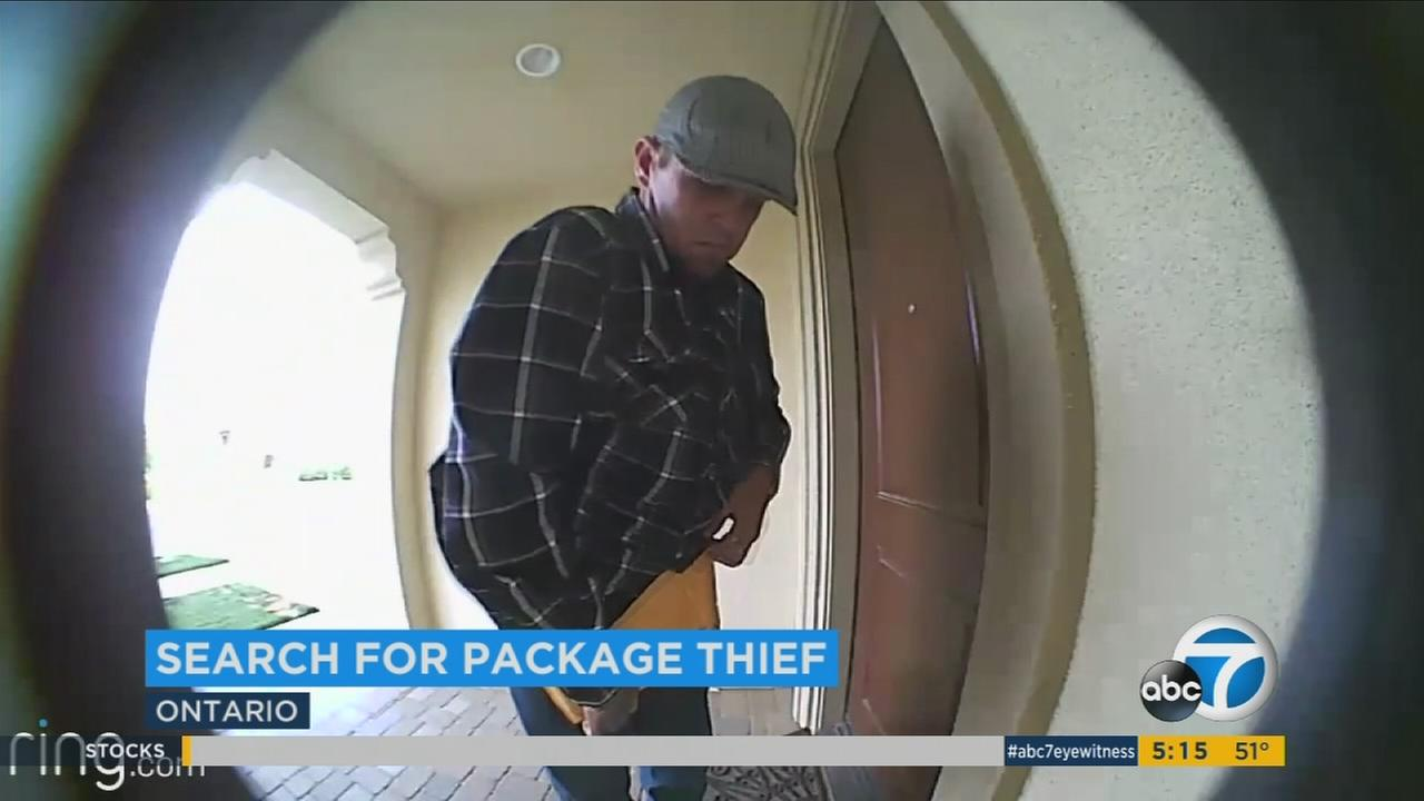 A package thief is seen on surveillance video apparently concealing a package under his shirt on Friday, May 5, 2017.